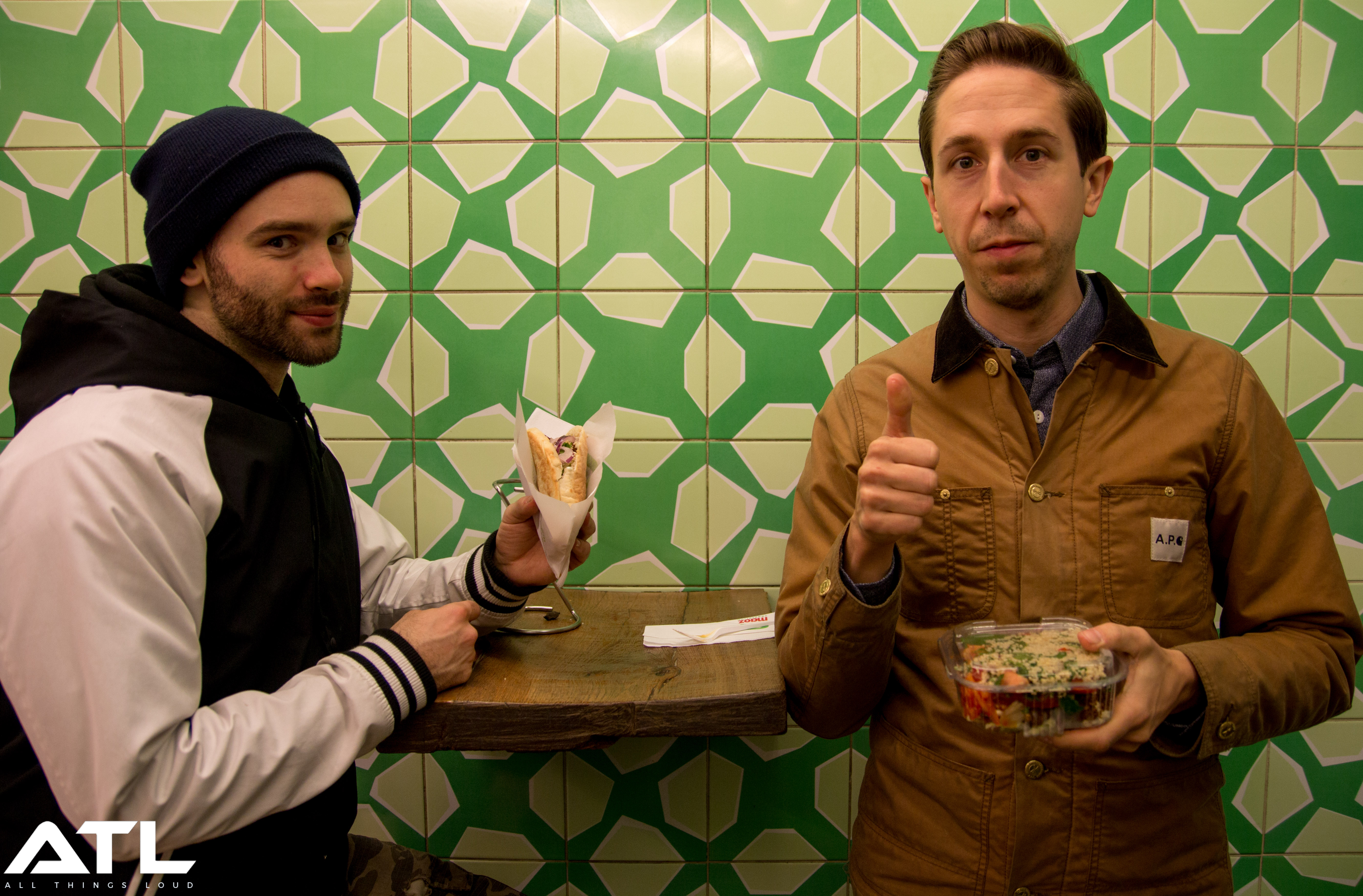 17:17. Tech guy Spencer and Silverstein drummer Paul Koehler show off their Falafels.