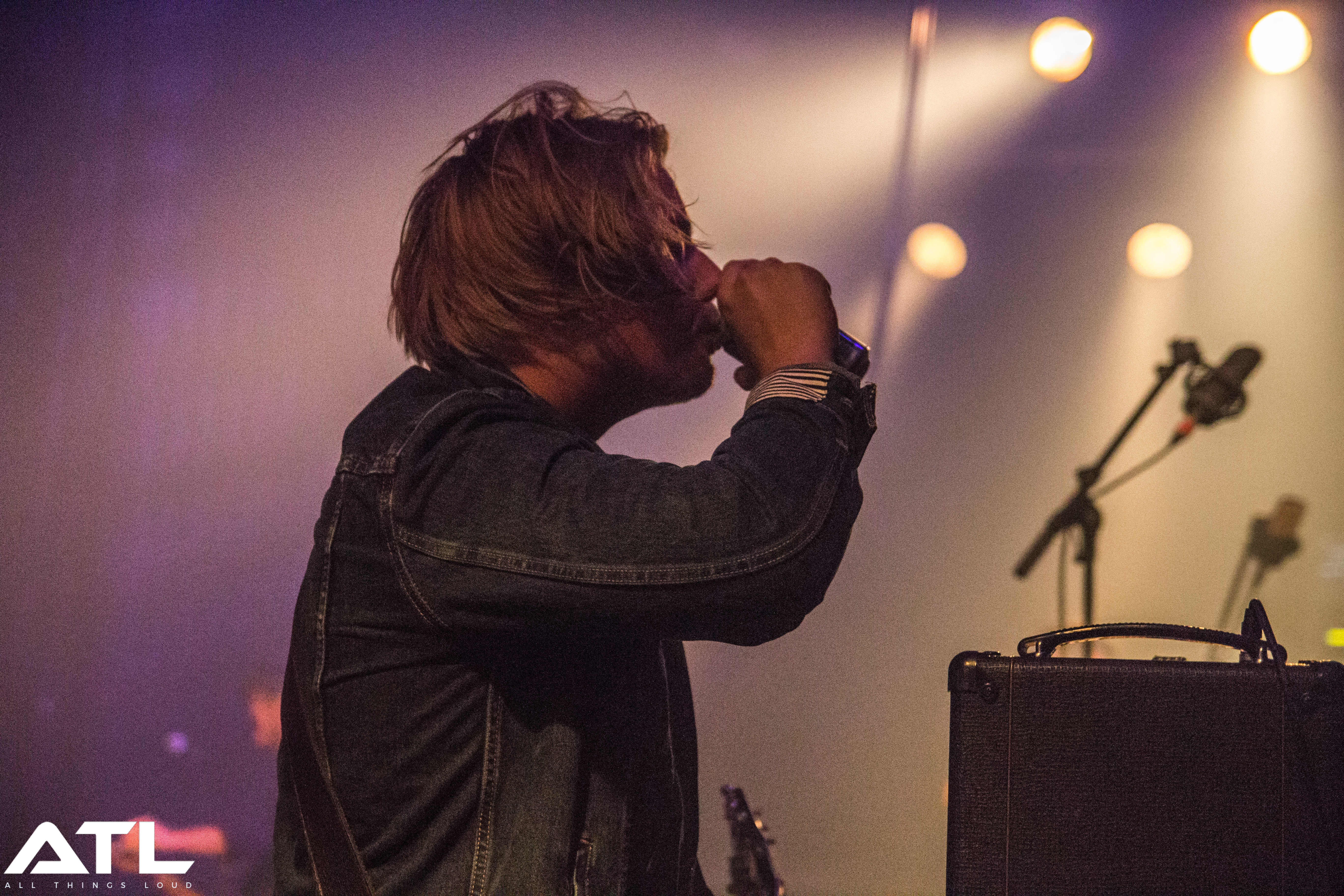 Nothing But Thieves' Joe downing a can of beer onstage in Amsterdam. (c) Jack Parker